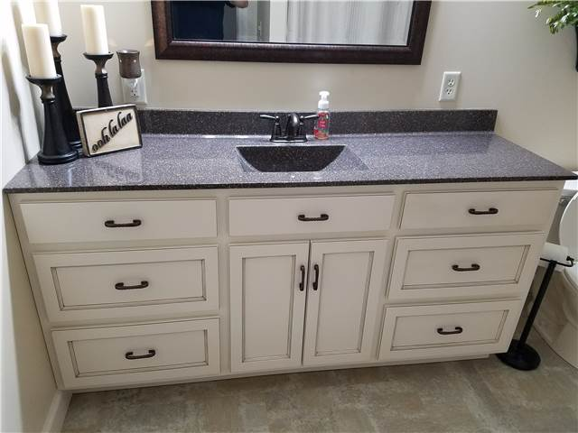 Painted and glazed cabinet - cultured granite countertop