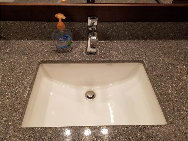 Cultured granite countertop with an undermount porcelain sink