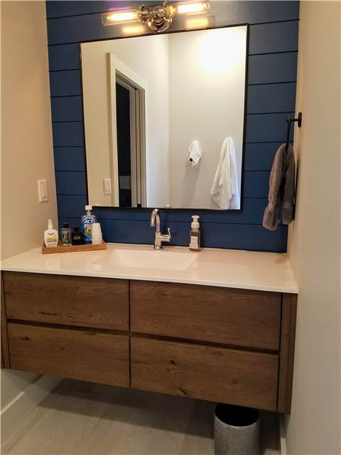 Rustic hickory floating vanity- stained - slab front - cultured marble countertop