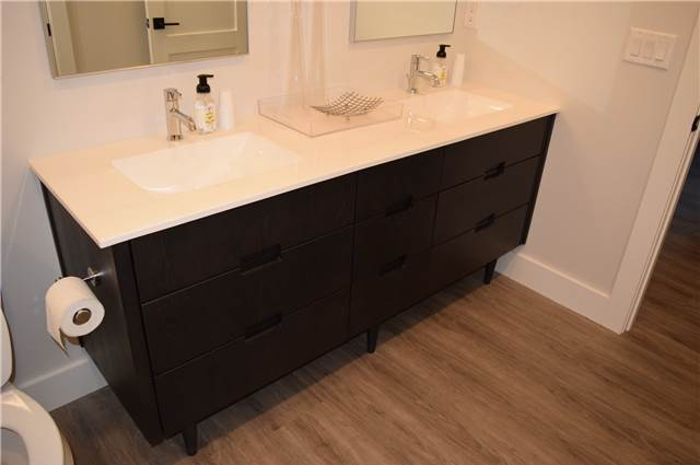 Stained hickory vanity on legs - Cultured marble countertop