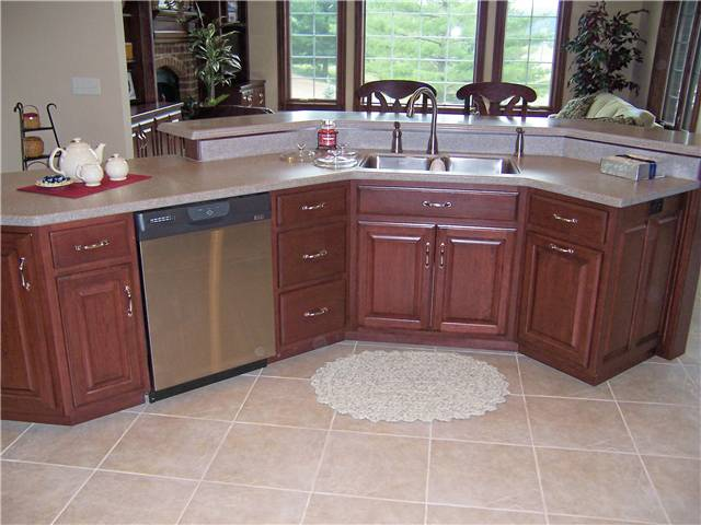 Solid surface, dual level island countertop with a stainless undermount sink