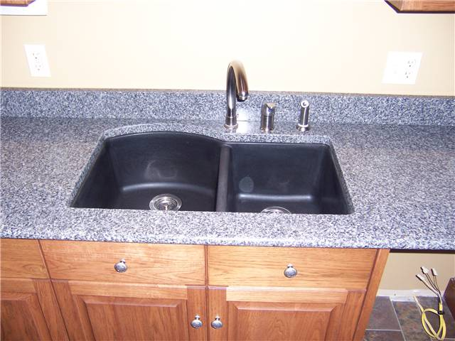Quartz countertop with a composite undermount sink