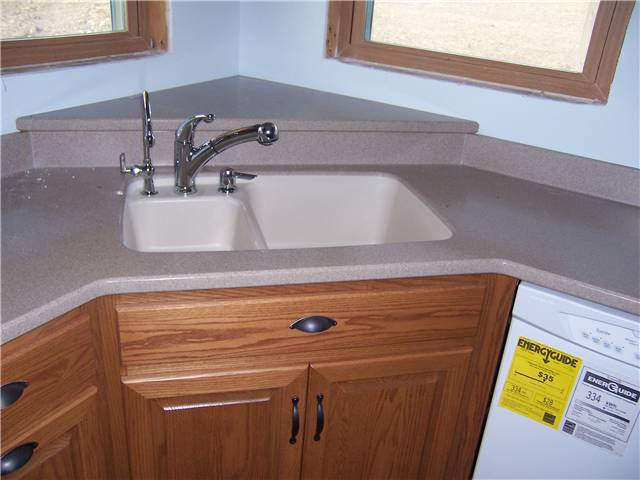 Corian countertops and undermount sinks sinks ideas for Stainless steel countertop with integral sink
