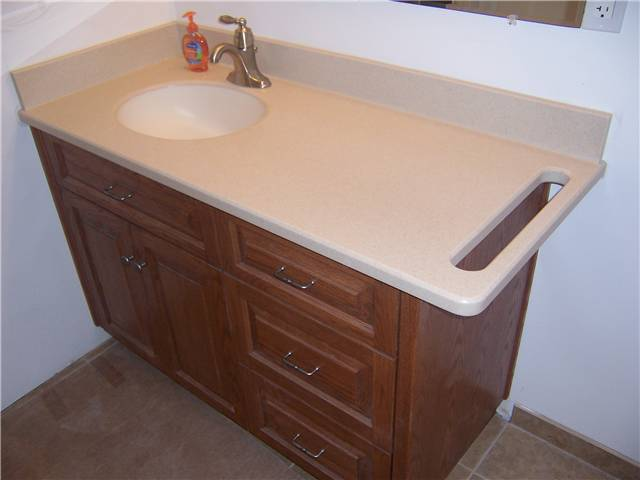 Corian Solid Surface Countertop, Undermount Sink, And Integral Towelbar
