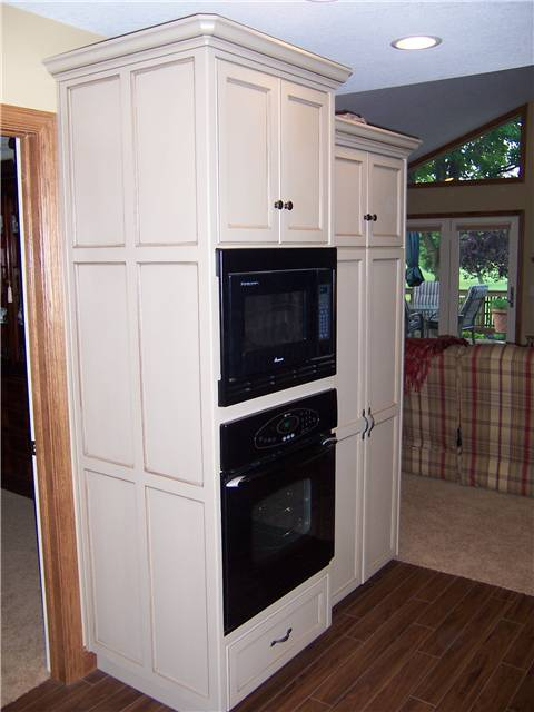Tall cabinet with flat panel side