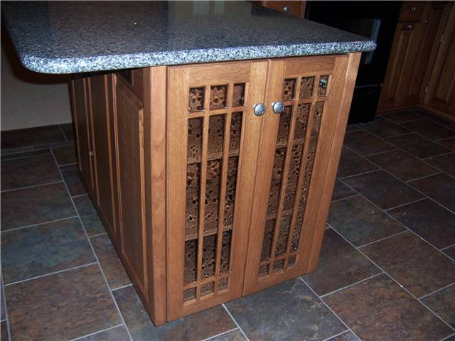 Glass doors on the end of a peninsula cabinet