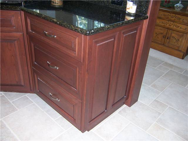 Base cabinet end with raised panels
