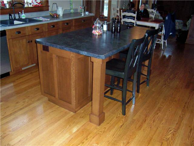 Island with a wood column under the countertop