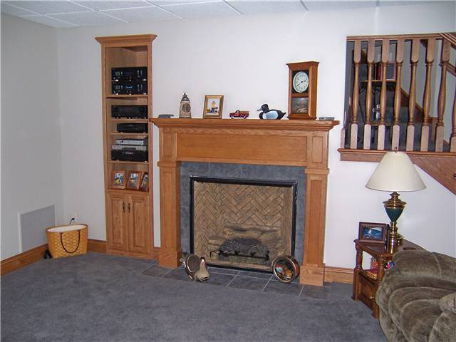 Fireplace mantel/Built-in bookshelves/storage - stained oak