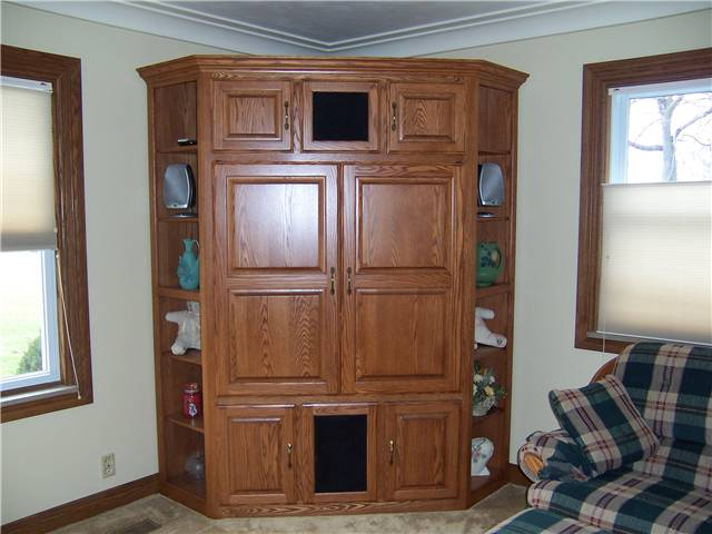 Entertainment center with pocket doors - stained oak