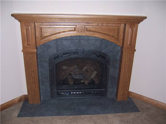 Fireplace mantel - stained oak with panels & fluting