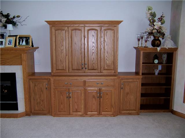 Home theater - stained oak - with bifold pocket doors