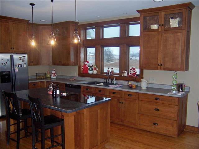 Quartersawn white oak cabinets - Flat panel doors, drawer fronts, and end panels - Full overlay style - Laminate countertops