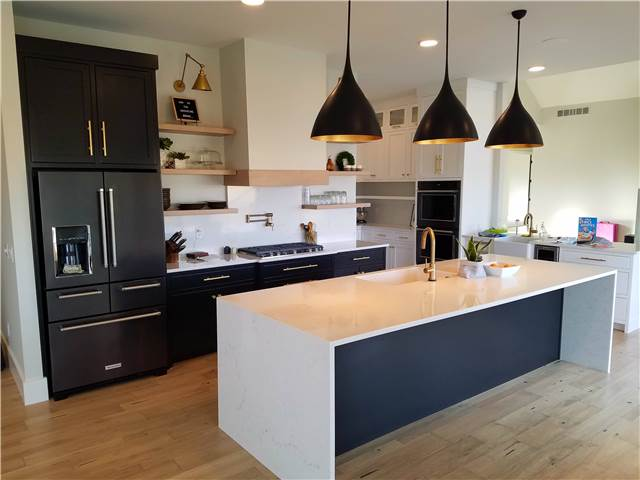 Painted maple cabinets - Quartz countertops with waterfall ends on the island