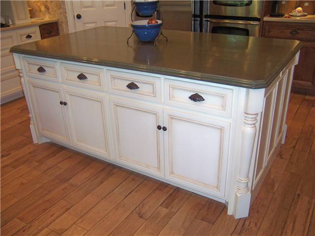 Painted and glazed island - Flat panel miter corner doors and drawer fronts - Standard overlay style - Corian solid surface countertop