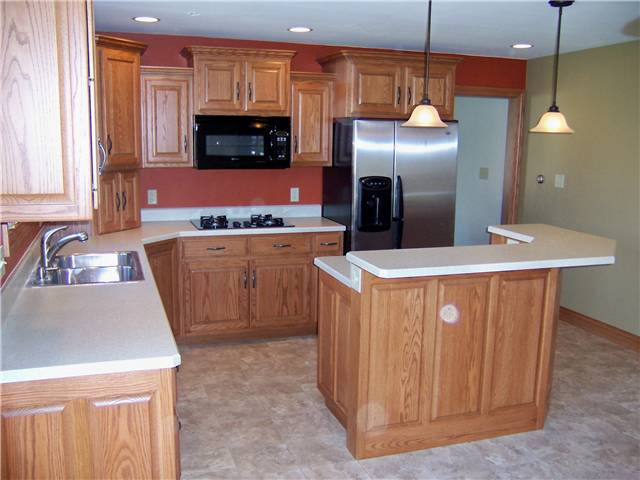 Red oak cabinets - Raised panel doors and side panels - Standard overlay style - Laminate countertops