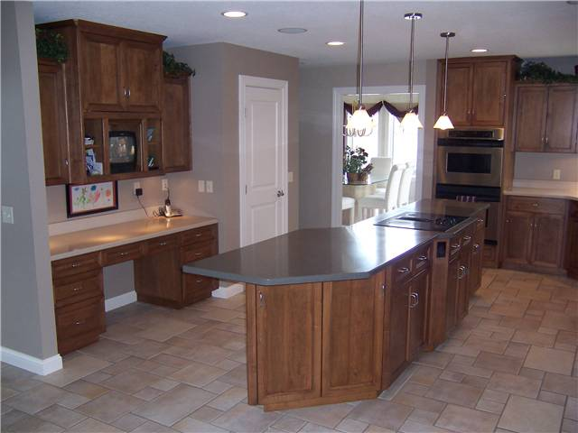Maple cabinets - Flat panel doors and drawer fronts - Full overlay style - Corian solid surface countertops