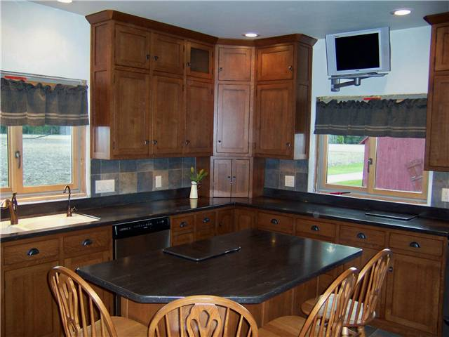 Quartersawn white oak cabinets - Flat panel doors - Inset style - Corian solid surface countertops