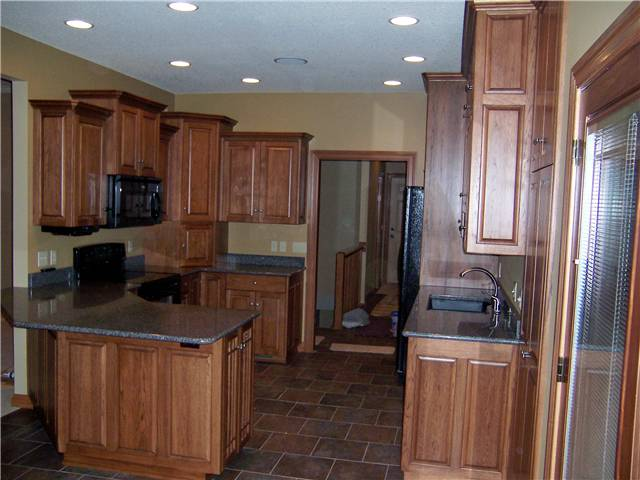 Hickory cabinets - Raised panel doors and side panels - Full overlay style - Quartz countertops