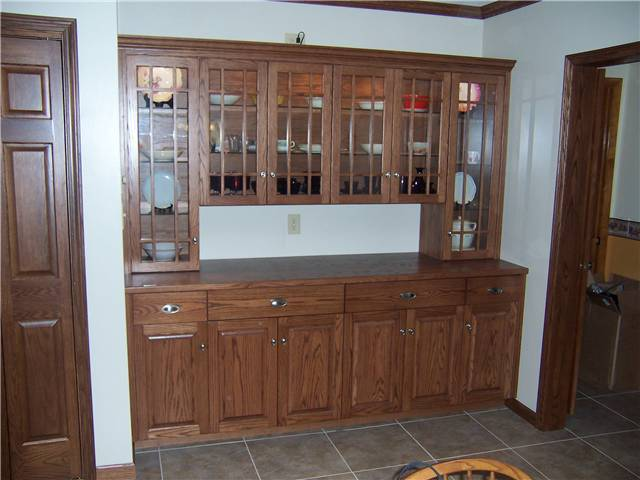 Red oak cabinets - Arts and crafts glass doors - Raised panel lower doors - Full overlay style - Wood countertop