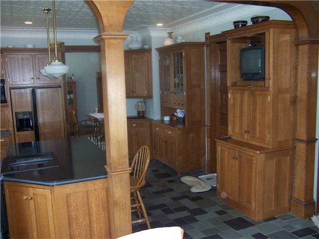 Quartersawn white oak cabinets - Flat panel doors and end panels - Inset style - Corian solid surface countertops