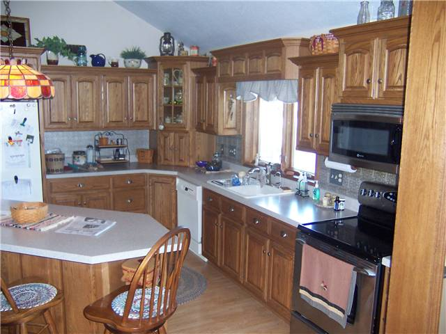 Red oak cabinets - Raised panel doors - Standard overlay style - Laminate countertops