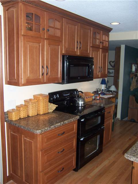 Hickory cabinets - Raised panel doors, drawer fronts, and side panels - Standard overlay style - Laminate countertops