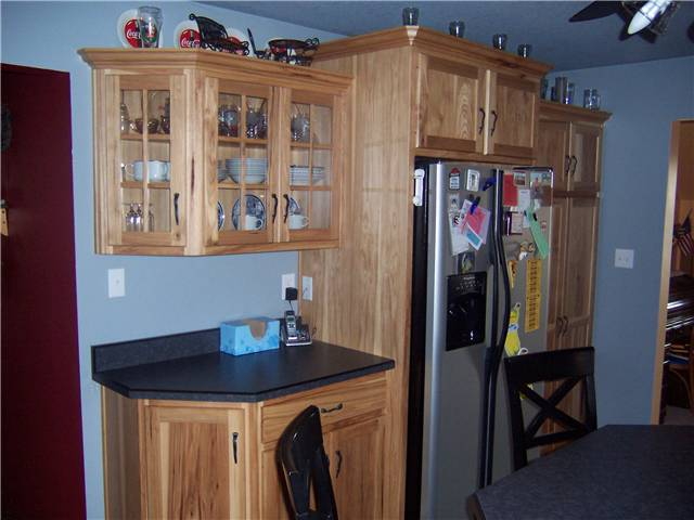 Rustic hickory cabinets - Flat panel doors - Standard overlay style - Laminate countertops