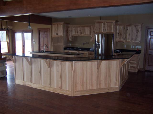 Rustic Hickory cabinets - Island with raised bar - Flat panel doors and side panels - Standard overlay style - Granite countertops