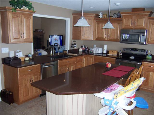 Cherry cabinets with natural finish - Painted island with glaze finish - Raised panel doors - Standard overlay style - Quartz countertops
