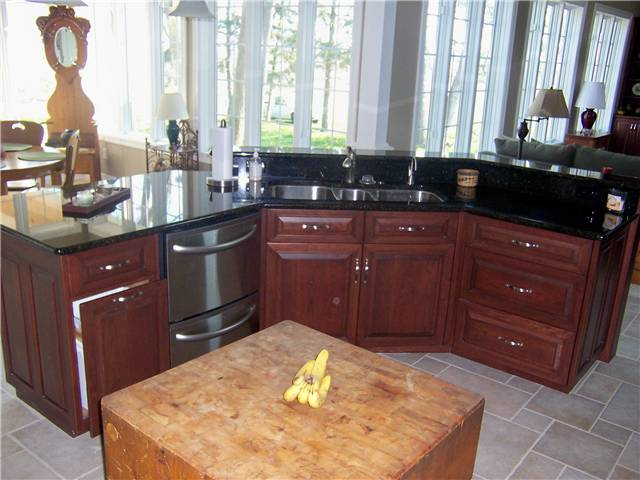 Cherry island - Raised panel miter corner doors and drawer fronts - Full overlay style - Granite countertop with a stainless steel undermount sink