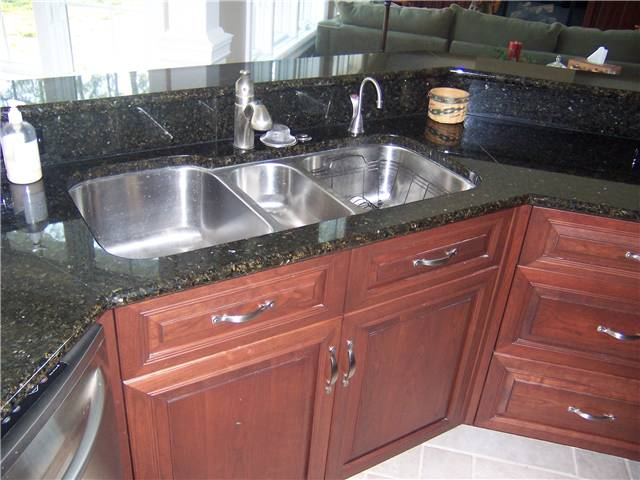 Granite countertop with a stainless steel undermount sink