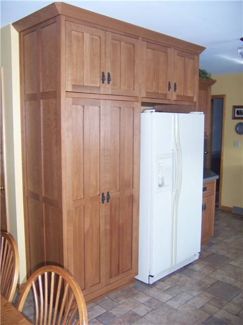 Quartersawn white oak cabinets - Flat panel doors, drawer fronts, and side panels - Inset style