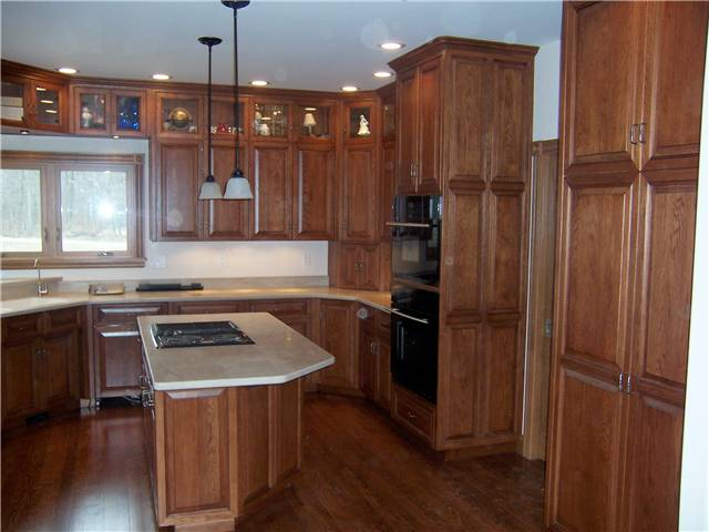 Hickory cabinets - Raised panel miter corner doors, drawer fronts, and side panels - Full overlay style - Corian solid surface countertops