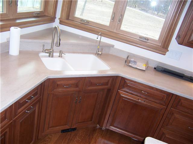 Hickory cabinets - Raised panel miter corner doors and drawer fronts - Full overlay style - Corian solid surface countertops with a Corian integral sink