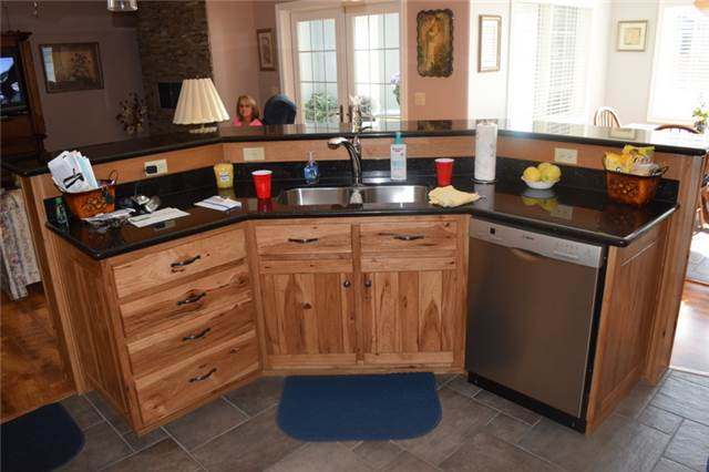 Rustic hickory island with a raised bar - granite countertops