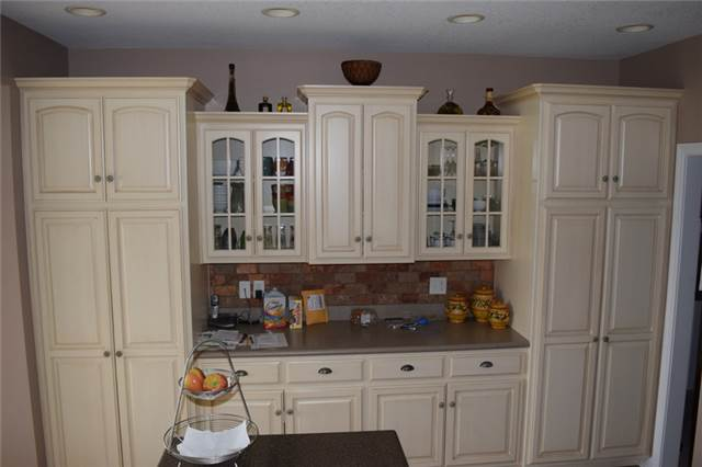 Painted & glazed cabinets - Corian countertops