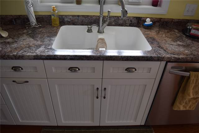 Painted cabinets with flat panel beadboard doors - full overlay style - Karran undermount sink - laminate countertop