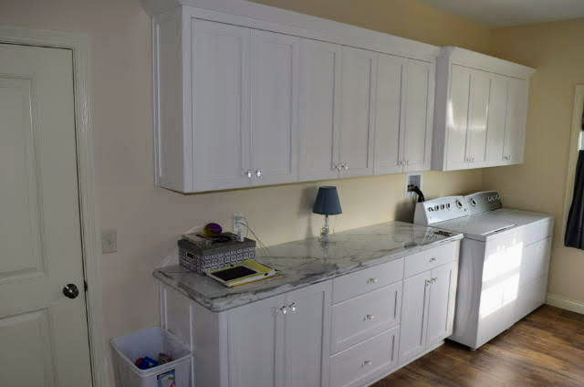 Painted cabinets - flat panel - full overlay - laminate countertop