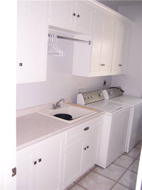 Painted cabinets - Laminate countertop - Clothes rod