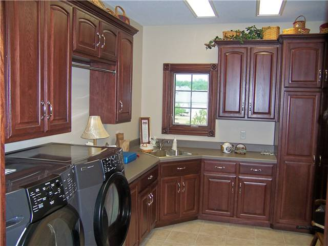 Hickory cabinets - Laminate countertop - Clothes rod