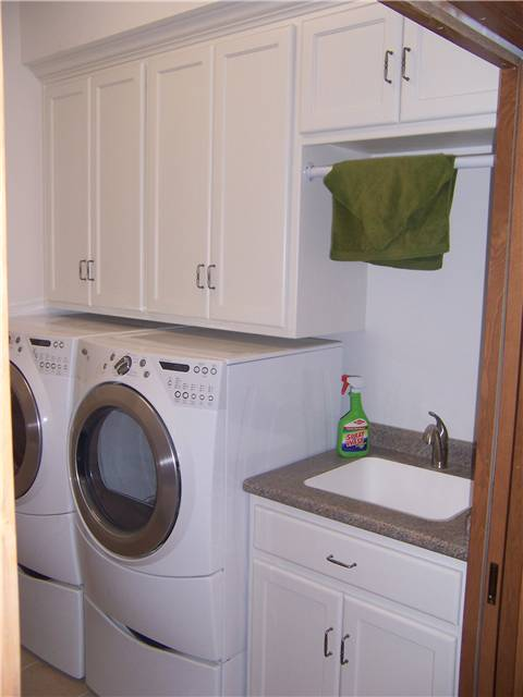 Painted Cabinets   Laminate Countertop With An Undermount Utility Sink    Clothes Rod
