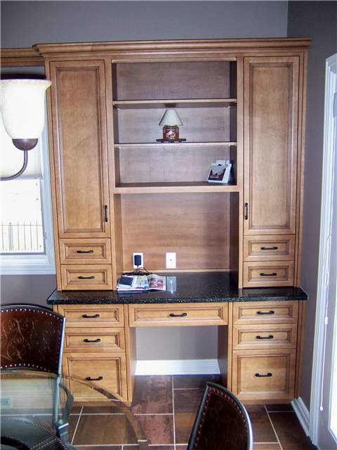 Maple desk with upper display and storage cabinets