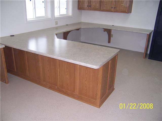 Small business office - oak cabinetry with laminate countertops