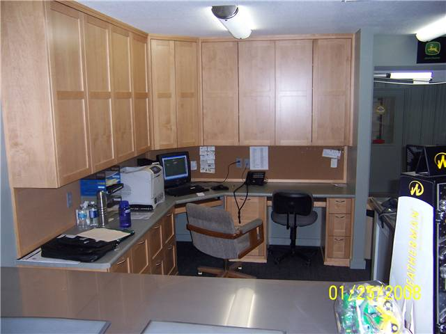 Maple computer desks with file drawers and upper storage cabinets. Farm implement dealer's office