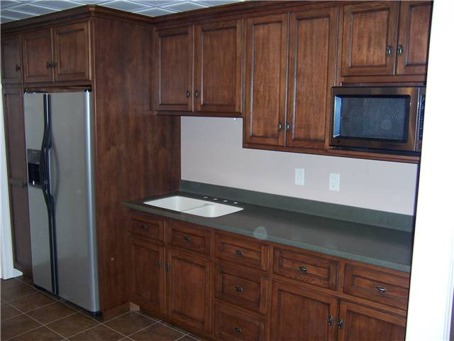 Hickory wood with dark brown stain and dark glaze